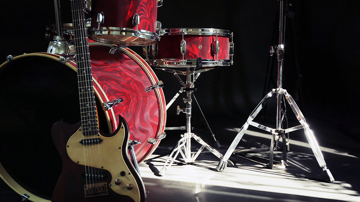 Red Drum Set and Guitar
